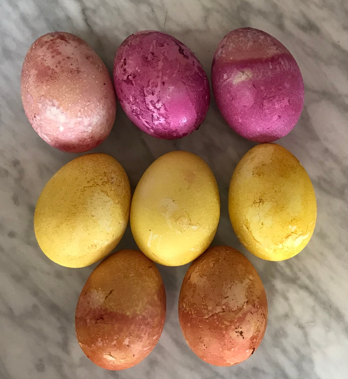 pink (beet dyed), yellow (turmeric dyed) and orange (mixed bath) eggs